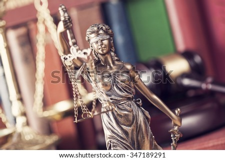 Law concept, statue, gavel, scale and books - stock photo