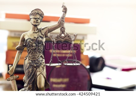 Law concept, statue, magnifying glass, passport and book  - stock photo