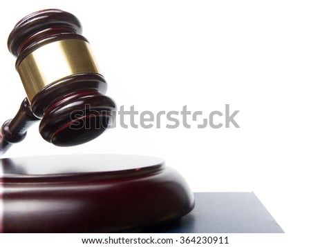 Law concept - Wooden judges gavel isolated on white background - stock photo