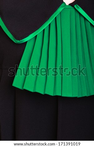 Law court or justice concept. Closeup of lawyer attorney classic polish (Poland) black green gown. - stock photo