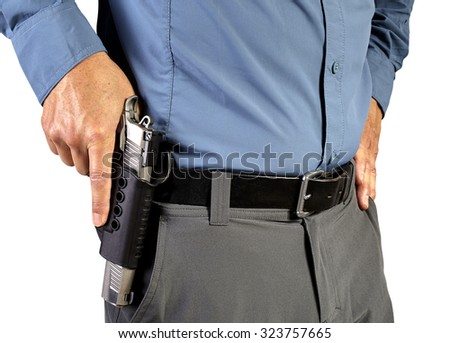 Law Enforcement Professional Man with Holstered Gun Weapon - stock photo