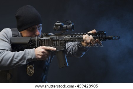 Law Enforcement Special Agent with weapon, sighting in on the target. - stock photo