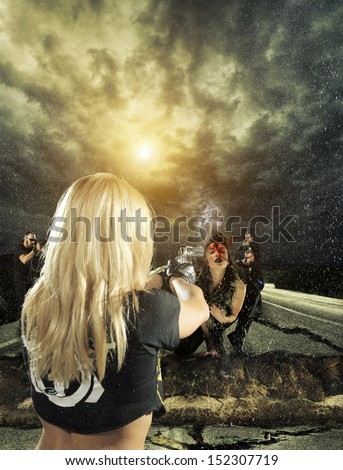 Law enforcement team hunting and shooting down a female vampire - stock photo