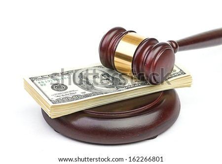 Law gavel on a stack of American money. - stock photo