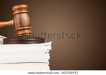 Law. Gavel on pile of documents - stock photo