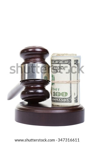 Law gavel with a roll of American money. - stock photo