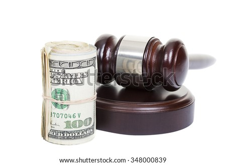 Law gavel with a roll of American money on white background. - stock photo