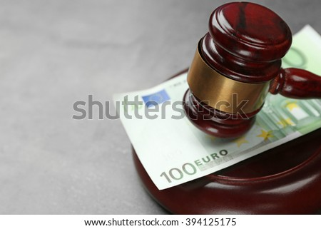 Law gavel with euro on grey background, closeup - stock photo