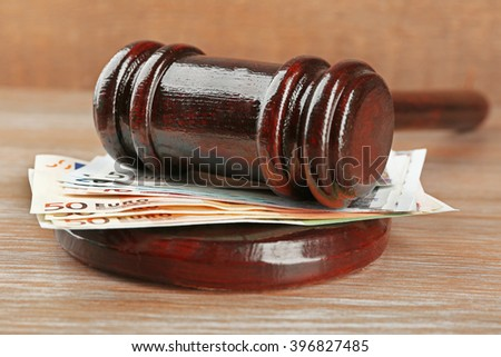 Law gavel with euro on wooden table background, closeup - stock photo