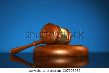 Law, justice and legal system concept with a wooden gavel judge symbol on blue background.