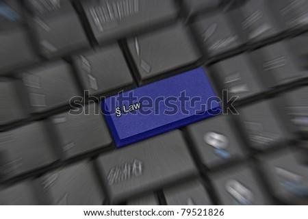 Law key on black computer keyboard - stock photo