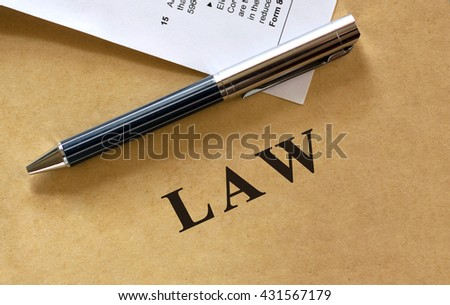 Law letters on grunge paper.  - stock photo