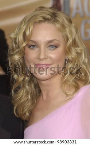 Law & Order star ELISABETH ROHM & date at the 10th Annual Screen Actors Guild Awards in Los Angeles. February 22, 2004