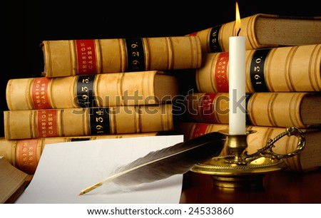 Law reports, quill pen and candle.