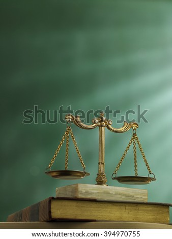 law scale on top of the law book - stock photo