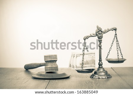 Law scales, judge gavel and cash money on table concept photo - stock photo