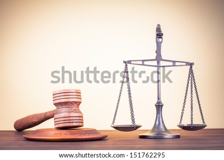 Law scales, judge gavel on table. Symbol of justice. - stock photo