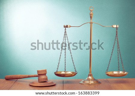 Law scales, judge gavel on table. Symbol of justice concept - stock photo