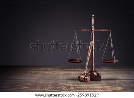 Law scales on table in front black background. Symbol of justice - stock photo