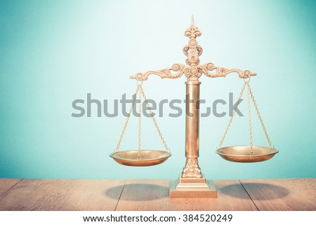 Law scales on table. Symbol of justice. Retro style filtered photo - stock photo
