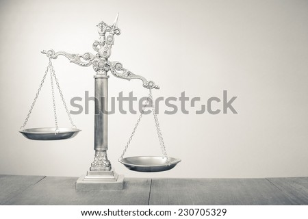 Law scales - Symbol of justice. Vintage old style black and white photo - stock photo