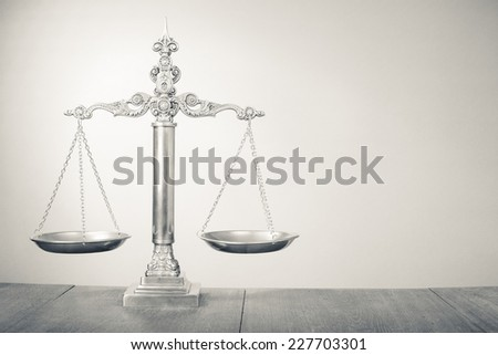 Law scales - Symbol of justice. Vintage old style sepia photo - stock photo