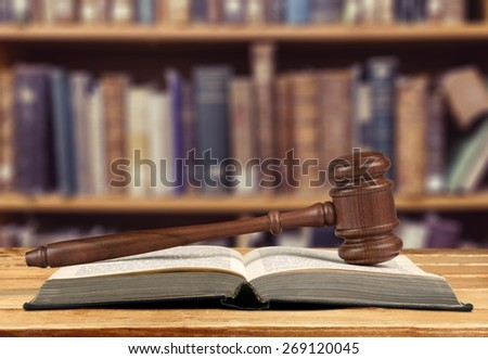 Law. Wooden gavel and law book - stock photo