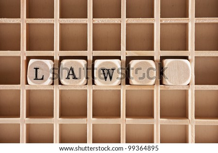 Law word construction with letter blocks and blank cubes for the law sign: ���§ - stock photo