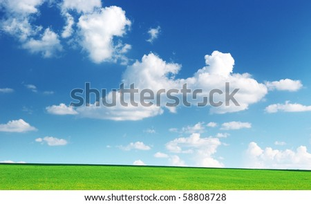 Lawn and cloudy sky. Nature composition. - stock photo