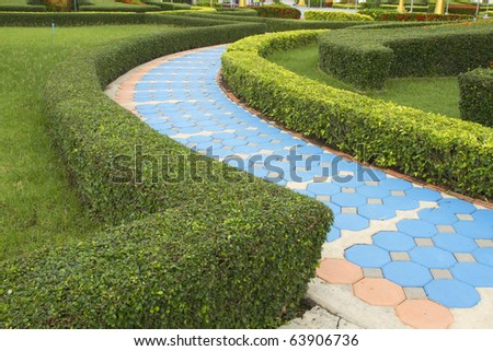 Lawn and concrete walkway. - stock photo
