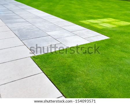 Lawn and path as abstract or background - stock photo