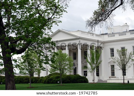 Lawn and trees in front of the White House in Washington DC - stock photo