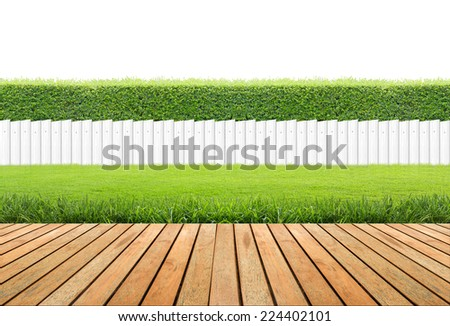 Lawn and wooden floor with hedge and White fence isolated. - stock photo