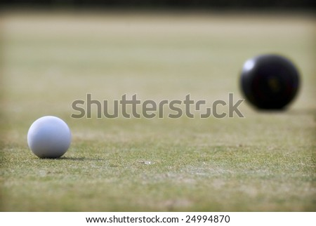 Lawn Bowls with narrow focus on the white ball