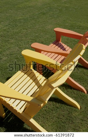 lawn chairs sitting on green lawn - stock photo