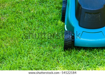 Lawn mover finished operating until short grass with front side horizontal view - stock photo