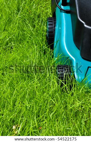 Lawn mover is going to be operated over long grass with front side view - stock photo