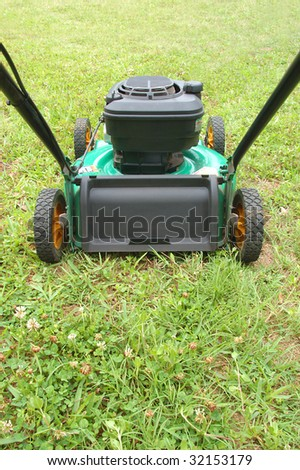lawn mover on green grass - stock photo