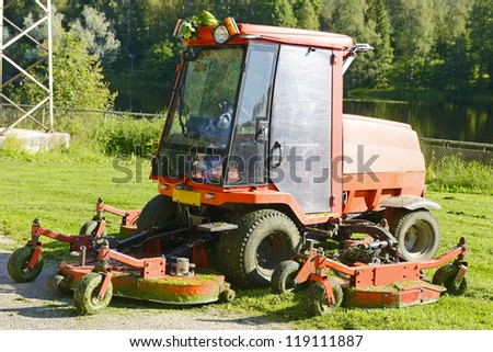 Lawn mower and green grass / lawn mower / gardening