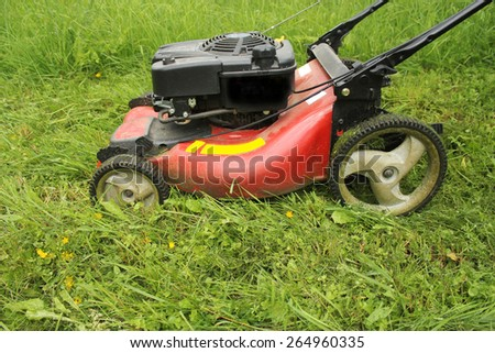 lawn mower cutting grass - stock photo