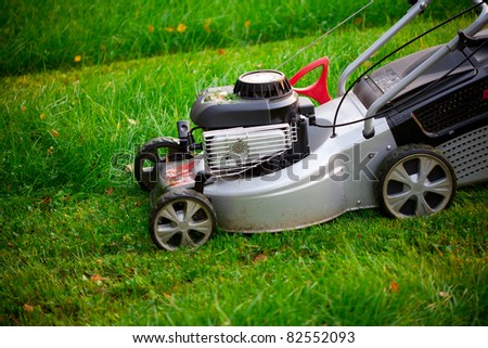 lawn mower cutting the grass - stock photo