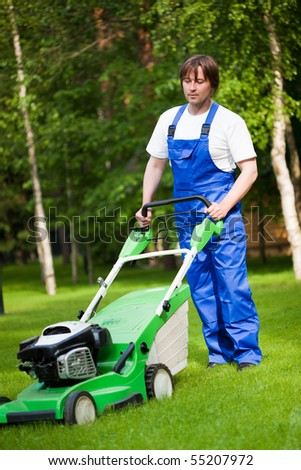 lawn mower man on the backyard - stock photo