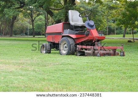 lawn mower on field - stock photo
