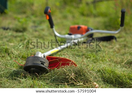 lawn mower on green grasss (selective focus) - stock photo