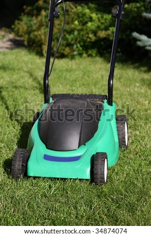 Lawnmower standing on grass