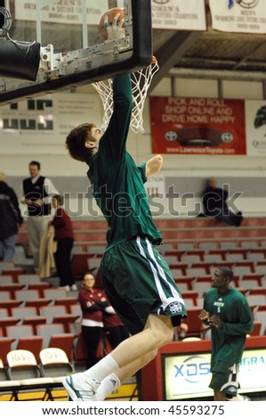 LAWRECEVILLE, NJ - JANUARY 28: Manhattan Jaspers basketball player Kevin Laue, born without one arm, goes for a slam in pregame drills prior to the January 28, 2010 game in Lawrenceville, NJ. - stock photo
