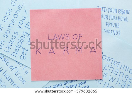 Laws of karma handwritten on remember note. - stock photo