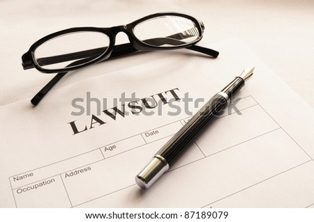 lawsuit form or document in business office - stock photo