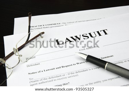 lawsuit form with glasses and pen - stock photo