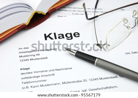 Lawsuit with book, glasses and filler - stock photo